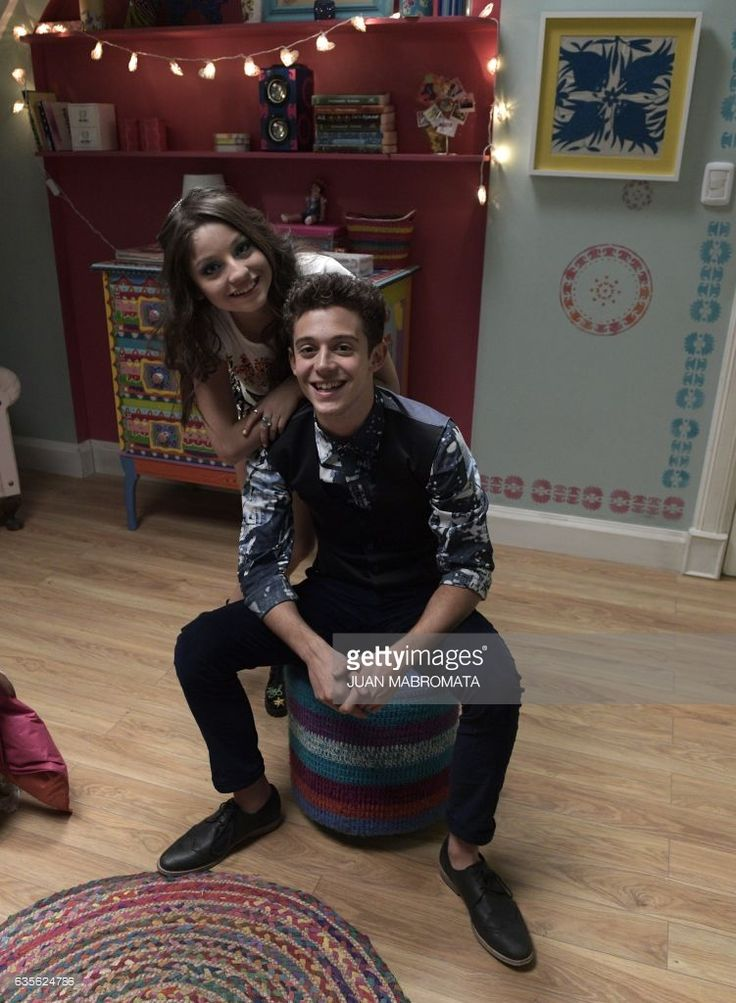 CORRECTION - Mexican actress Karol Sevilla (L) and Italian actor Ruggero Pasquarelli speak with AFP during an interview on a set of the Disney TV Series 'Soy Luna 2' in Don Torcuato, Tigre, in Buenos Aires outskirts, on July 21, 2016. Sevilla plays 'Luna', the main character of the series, and Pasquarelli plays 'Matteo', Luna's boyfriend. / AFP / JUAN MABROMATA / TO GO WITH AFP STORY BY SEBASTIAN VARELA / The erroneous mention[s] appearing in the metadata of this photo by JUAN MABROMATA has…