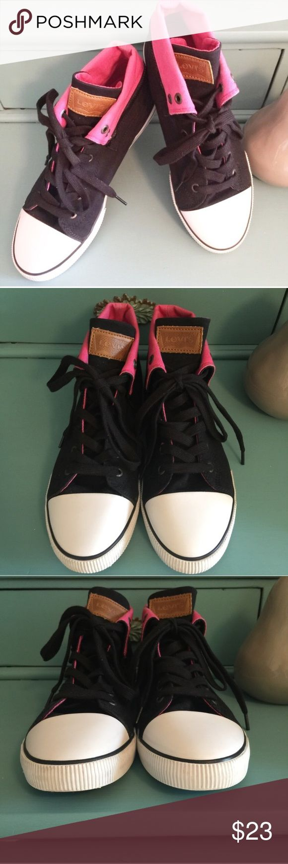 Levi's Black & Pink Rolled Down High Top Sneakers A classic brand Levi's version of a competitors.  This rolled down Lace-up high top sneaker is in really good used condition.  The Contrasting pink (to the black) is rolled and tacked down and has a working embellishment zipper.  Heel shows some wear down from walking though the soles are in really good condition.  Some fading/discoloration on the pink rolled down canvas.  Great to wear with jeans, shorts, and why not a dress or skirt!  They…