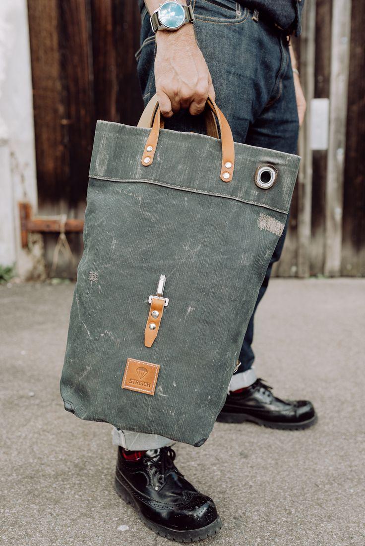 bruno streich and his SANTORINI bag out of world war ll swiss army tent canvas and french army gunbelts. #streichbag #canvasbag #armystyle #brunostreich #denim #selvedgedenim