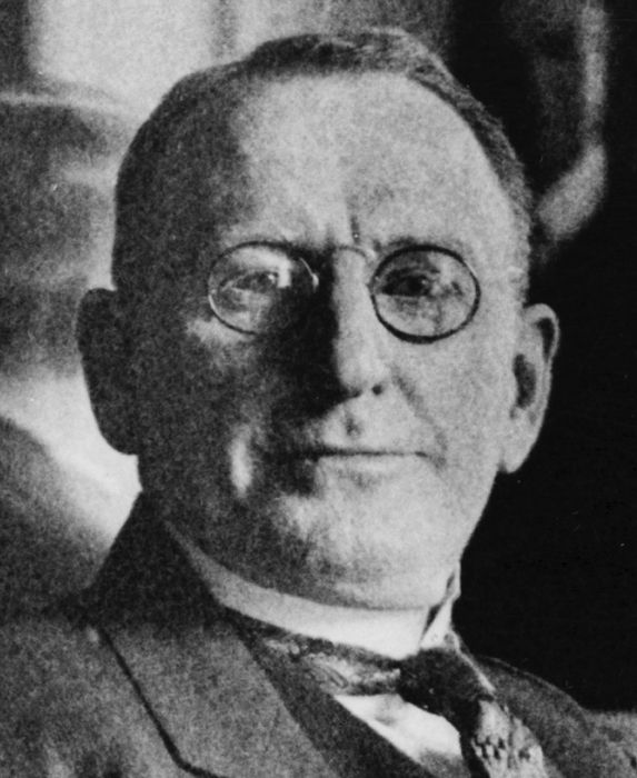 William Joseph Simmons founded the 2nd KKK in 1915. The KKK promoted a program called Americanism. He introduced the burning cross.