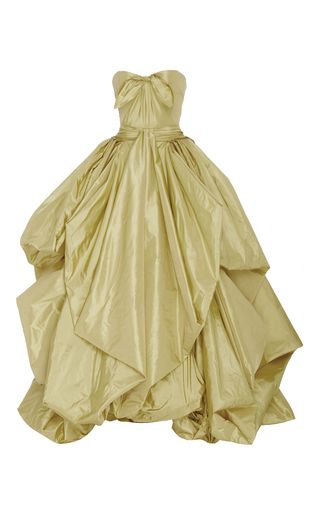 This **Zac Posen** gown features a sweetheart neckline, center bow detail, and a tiered skirt.