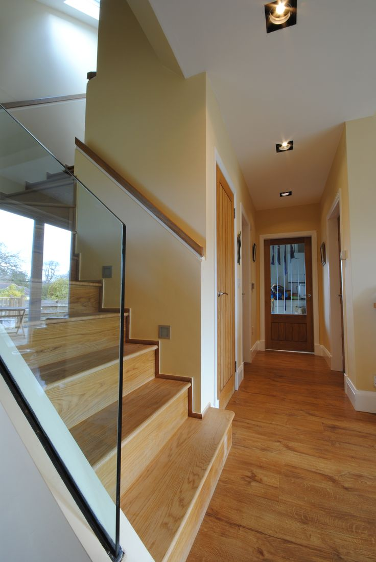 solid oak staircase, solid oak doors and solid oak floors. frameless glass balustrade in our house extension design in Hamilton, Scotland by Allison Architecture, Glasgow Architects.