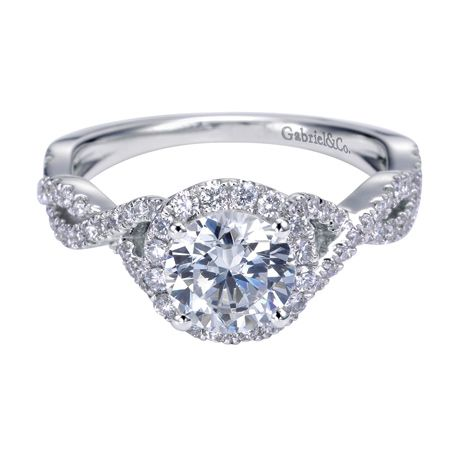 This ring has a modern design, but its beauty is timeless. She will forever love you and this 14K White Gold Round Diamond Side-Stones Contemporary Halo Engagement Ring from Gabriel & Co. Available at Wesche Jewelers. www.WescheJewelers.com
