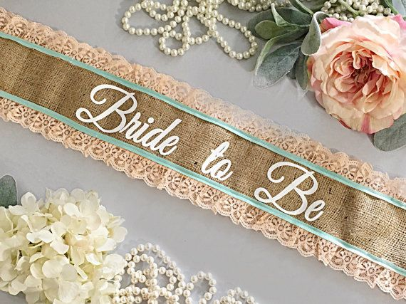 Want to stand out at your bachelorette party, Bridal Shower, or Baby Shower? it with our Custom Sashes! These sashes are personalized just for you.    These rustic burlap and lace sashes are all hand made just for you and your friends. All sashes are made extra long and measure at 72 and are left open to fit most brides, and mommies to be. Each sash has a pin closure.    Pictured is a burlap sash with peach lace and mint accent.    If you have other colors in mind, just send me a message. We…