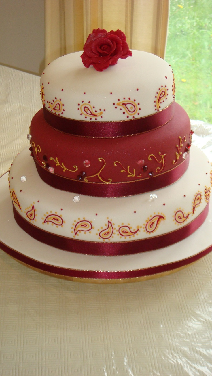 A Ruby Red And White Eggless Cake With Patterns That Match The Theme Of Wedding