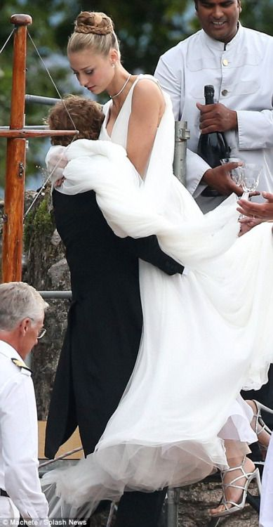 casiraghitrio: Wedding Reception of Pierre Casiraghi and Beatrice Borromeo, Lake Maggiore, Italy, August 1, 2015-the groom helps the bride into the boat on their way to the reception