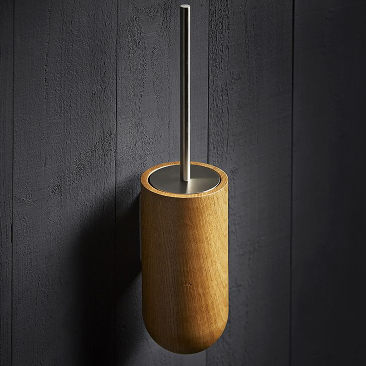 The Holt toilet brush holder is crafted in the UK from FSC accredited oak and then precision finished with 5% matt interior lacquer. A durable steel fixing bracket is secured to the oak holder and a black plastic liner is placed within the holder. Finally, a brush with satin stainless steel lid and handle is placed within the holder.