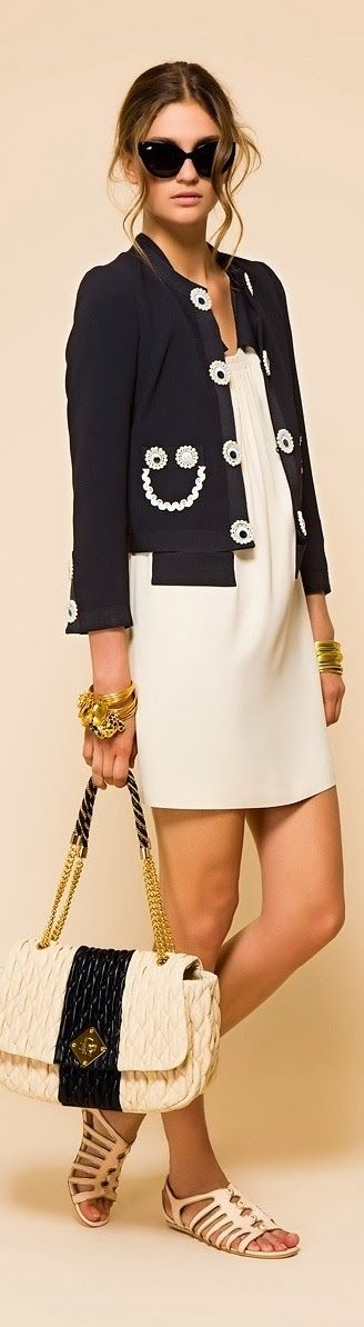 Fashionable white dress with beautiful dark blue jacket and white out bag