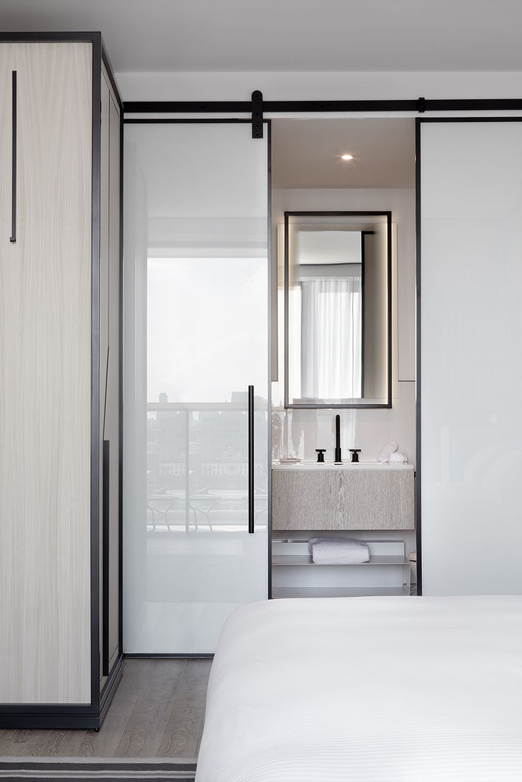 The William Vale | Studio Munge | Sliding door adds to limited space.