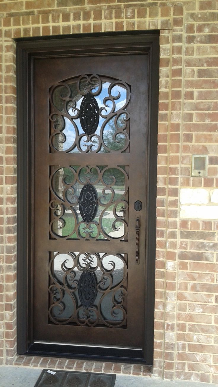 Custom single wrought iron door for Wrought iron entry doors