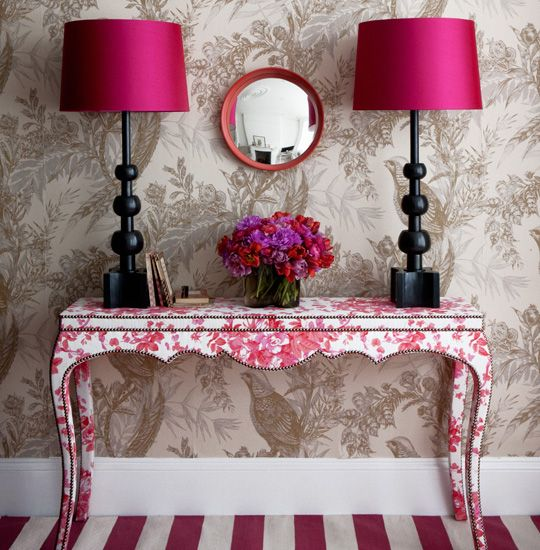so many great diys here:  toile fabric as wallpaper, paint a drop cloth w/ stripes & decoupage a dreamy table and add nailhead -- swirl some black paint inside a clear, square cheapo vase -- recover some basic white shades to shades of magenta -- an embroidery frame & mirror -- yikes just gorgeous & doable