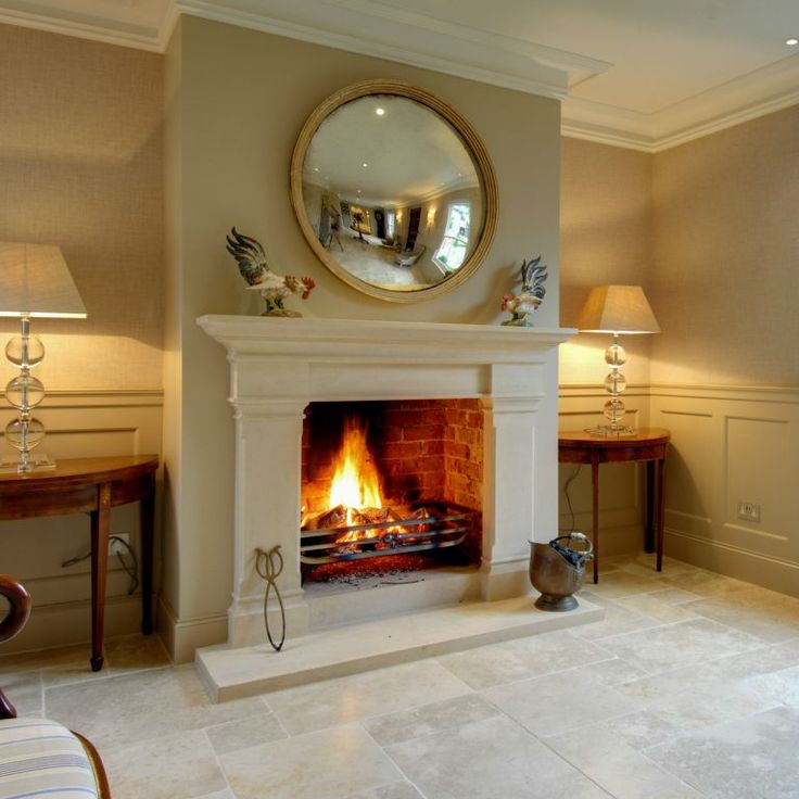 Bath stone Georgian fireplace. Beautiful room with stone flooring, panelling & soothing paintwork.