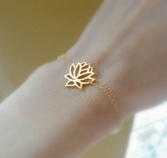 Lotus Blossom Bracelet: This delicate and simple gold bracelet ($29) is a reminder of the beauty and strength within.  Want in silver