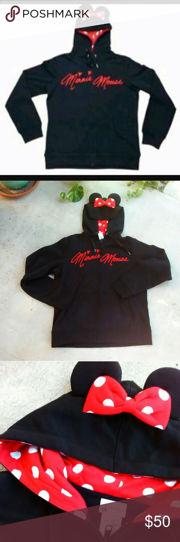 NWT MINNIE MOUSE EAR  BLACK ZIP UP HOODIE -BRAND NEW WITH TAG -MINNIE MOUSE SIGNATURE EAR HOODIE  -HEAVY DUTY ZIPPER AND HOOD TIES WITH/ BLACK METAL ACCENTS  -MINNIE MOUSE'S SIGNATURE ON FRONT  -HOOD W/EARS & POLKA DOT BOW AND LINED IN RED W/WHITE POLKADOTS  -GET EXCLUSIVELY ONLINE DISNEY OFFICIAL WEBSITE FOR: 64.99 + 5.25 + 9.95 OR AT A DISNEY PARK FOR : 75.99 + TAX !!!!  -IF U WANT A FITTED HOODIE IT FITS TRUE TO SIZE BUT I LIKE MY HOODIES A LITTLE BIG SO IM A SIZE M AND WEAR THIS…