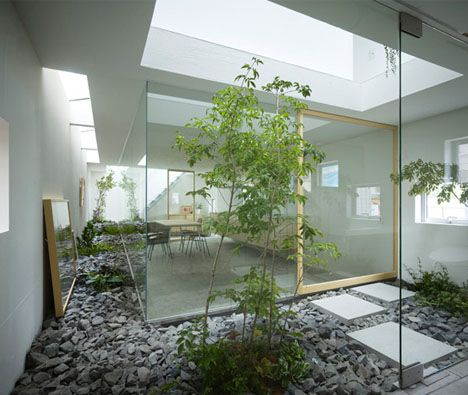 This interior design brings the best of simple modern minimalism together with a light and spacious atmosphere and plenty of plant-life climbing all the way up and down the inside walls.