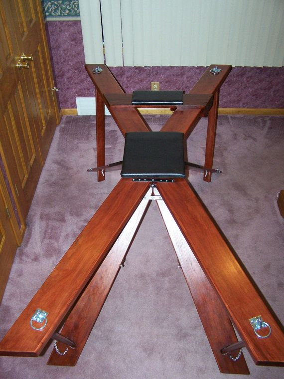 "Solid Cherry. WOULDN'T YOU PREFER TO HAVE YOUR OWN DUNGEON THAT CAN BE SET UP IN MINUTES AND STORED QUICKLY AND IS BEAUTIFUL TO LOOK AT? The ""Dungeon in a Bag"" is a St Andrews Cross, Bondage Table and a Spanking Bench that is a sturdy and beautiful piece of furniture that fits in a travel golf bag for easy and discrete storage"