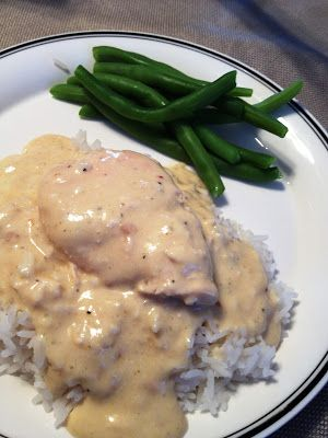 Creamy Crock Pot Chicken : 2-4 frozen or thawed chicken breasts, 8 oz cream cheese, 1 can cream of chicken, 1 pkg dried italian dressing seasoning, 2-4 servings rice