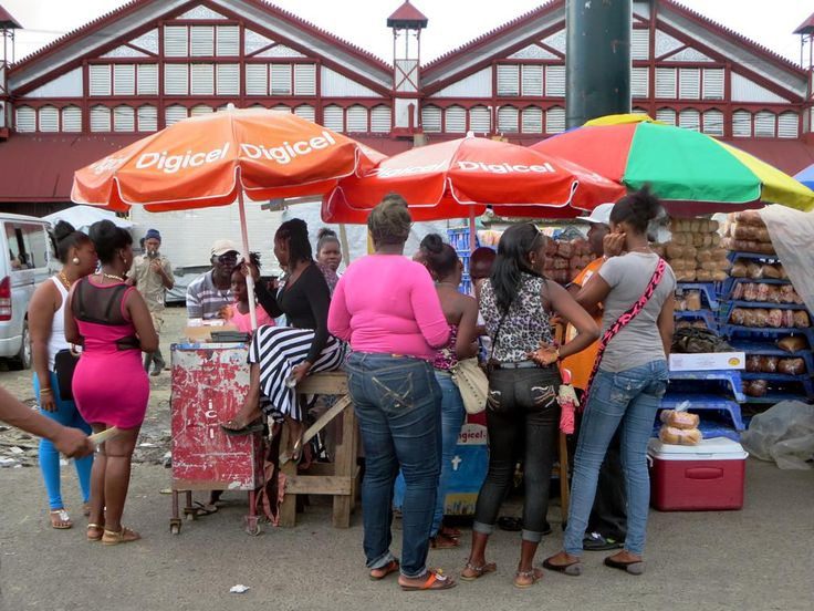 Female shoppers pause at a stall on Water Street outside the Stabroek Market in Georgetown, Guyana. The city has a Caribbean air quite unlike most other South American capitals.