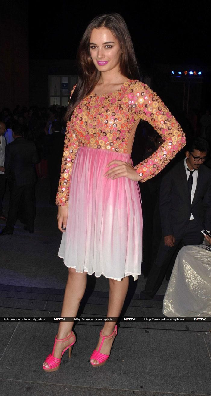 Actress Evelyn Sharma looked beautiful in a pink and white dress with a sequinned bodice. She finished her look with pink heels.