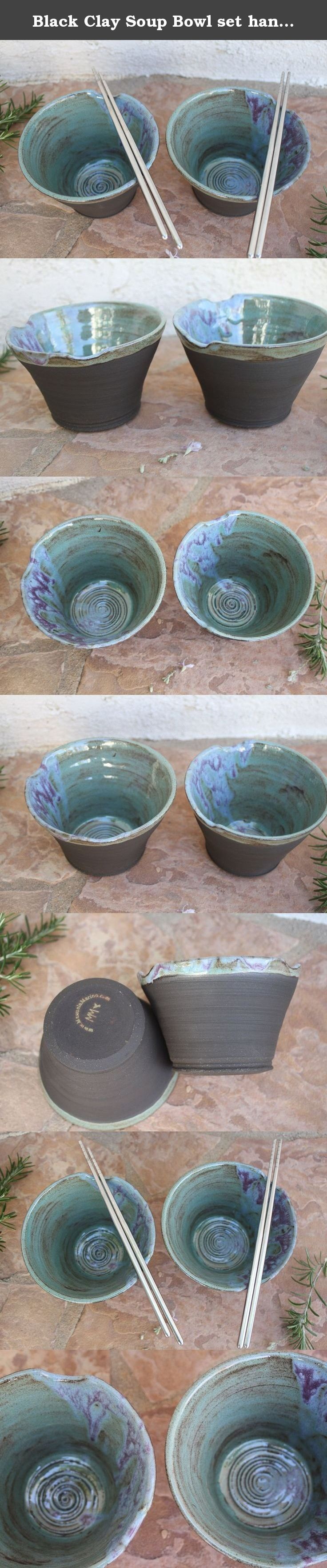 """Black Clay Soup Bowl set handmade ceramic ramen dish rice bowls rustic modern kitchen pottery. These bowls are ideal for rice or soup dishes. Cutouts make it easy to store your chopsticks. Seafoam glaze with purple and blue drip effects make this a one-of-a-kind gift for a couple. Chopsticks not included. About 4"""" (10.1cm) high and 5.5"""" (14cm) wide on top. The outside is only partially glazed to show off the beautiful dark clay, providing a nice contrast to the smooth interior. Food..."""