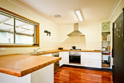 White cabinets with bamboo benchtop concepts for clients for Bamboo kitchen cabinets australia