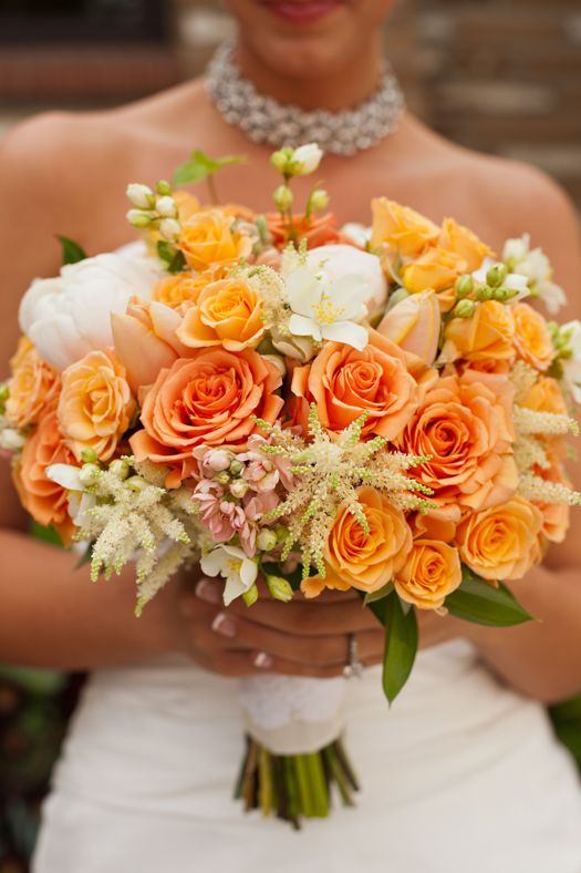 pretty, thinking about choosing orange as a color! would definitely love some roses for the bridal bouquets.