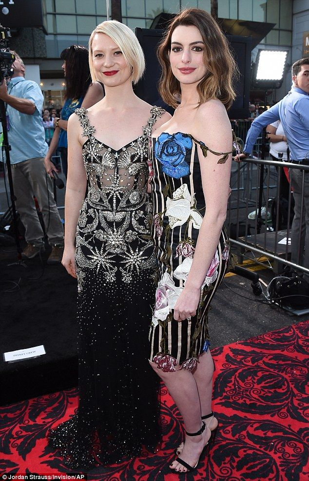 Gorgeous gals! The new mom posed withMia Wasikowska, 26, who stars as Alice in thesequel to Tim Burton's 2010 film Alice In Wonderland