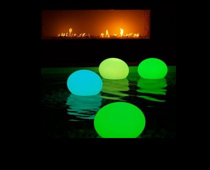 Glow stick in a balloon for pool party decoration or a game of night volleyball