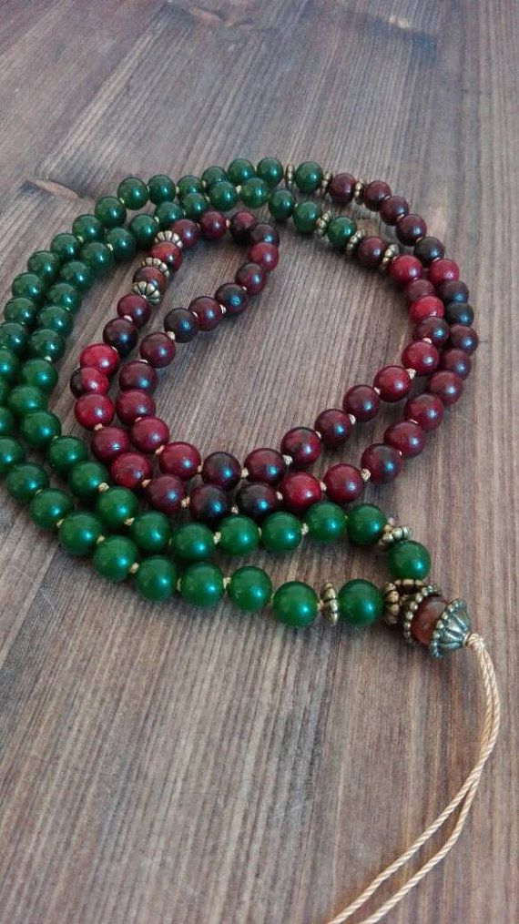 Check out this item in my Etsy shop https://www.etsy.com/listing/246264439/mala-made-of-108-wooden-and-jade-beads