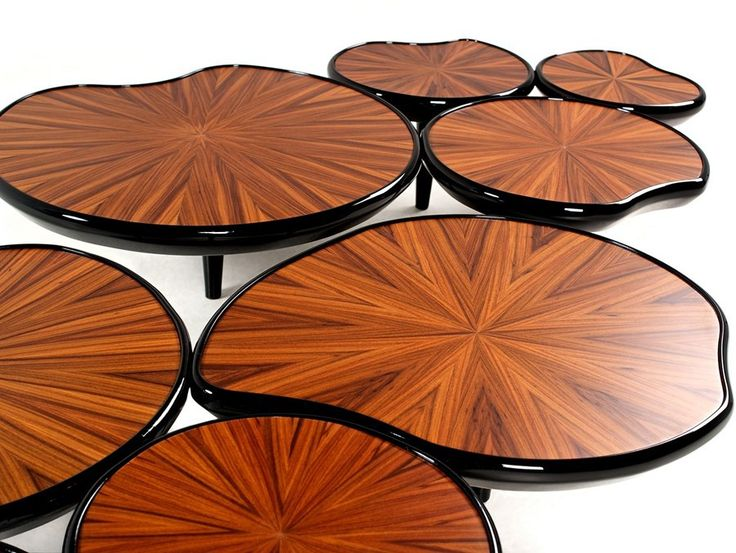 These Caviuna wood tables boast water lily shapes in rich shades of brown, finished with black lacquer legs, designed by Malabar. http://www.zocko.com/z/JHlIE