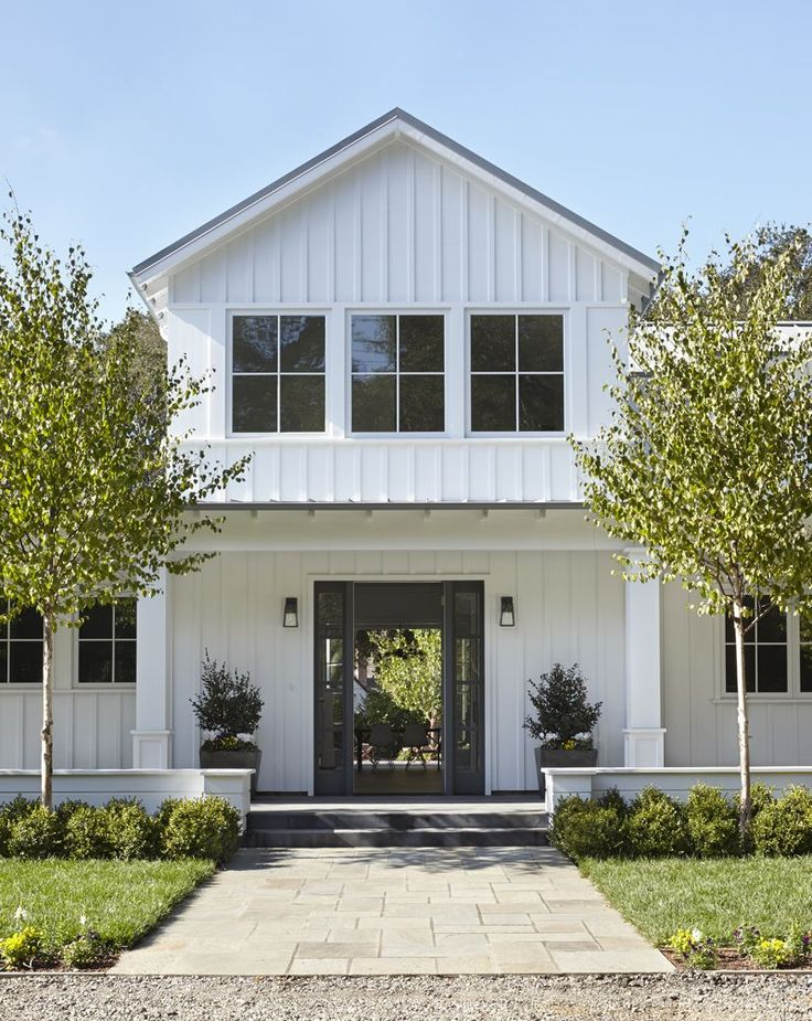A Modern Farmhouse in San Mateo County   Architecture by Lauren Goldman of l'oro design   Interior Design by Jeanne Moeschler of jm.ID.   Photography by Muffy Kibbey   Modern Sanctuary   Entry   Modern Entry   Exterior   Porch   Lighting   Outdoor Lighting