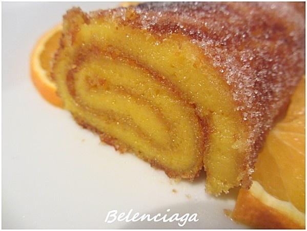 Pastel de naranja (Orange cake) receta portuguesa / 8 huevos.  320 g de azúcar.  Azúcar para espolvorear.  Zumo de 2 naranjas.  Ralladura de 2 naranjas.  1 cucharada rasa de harina.  75 g de mantequilla.  Mantequilla para untar