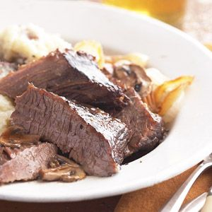 Marinate beef brisket overnight in red wine and beef broth for fall-apart tender results.