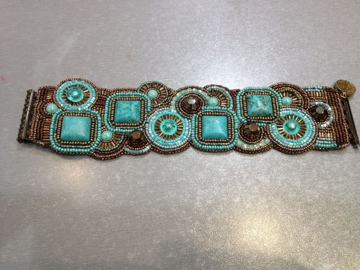 Beaut Embroidered Geometric CUFF. Love the use of turquoise.