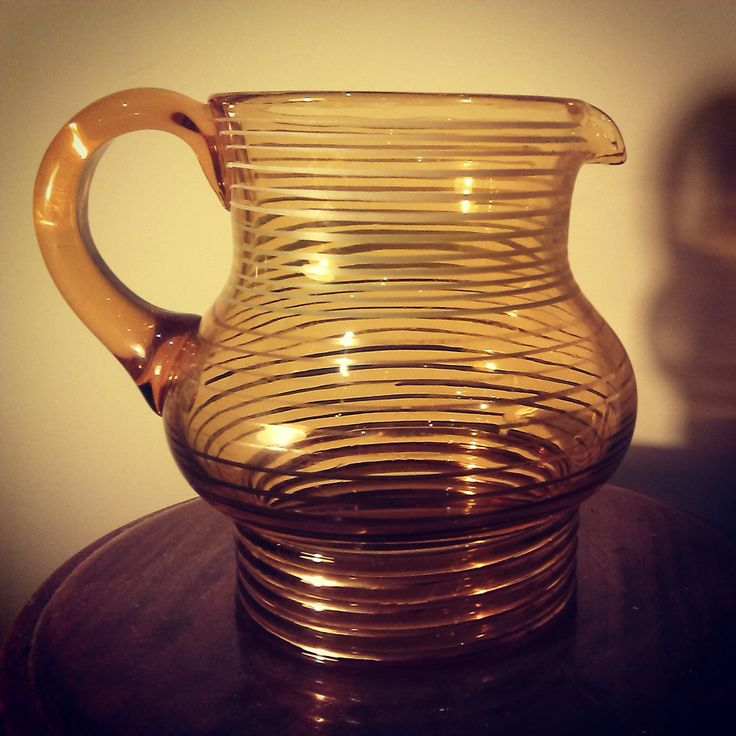 Amber glass jug with gold striping.