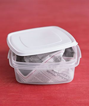 "Stuff a balled-up piece of newspaper into a plastic container that has developed a ""SMELL"", and let it sit overnight. By morning the paper will have absorbed the offending smell."