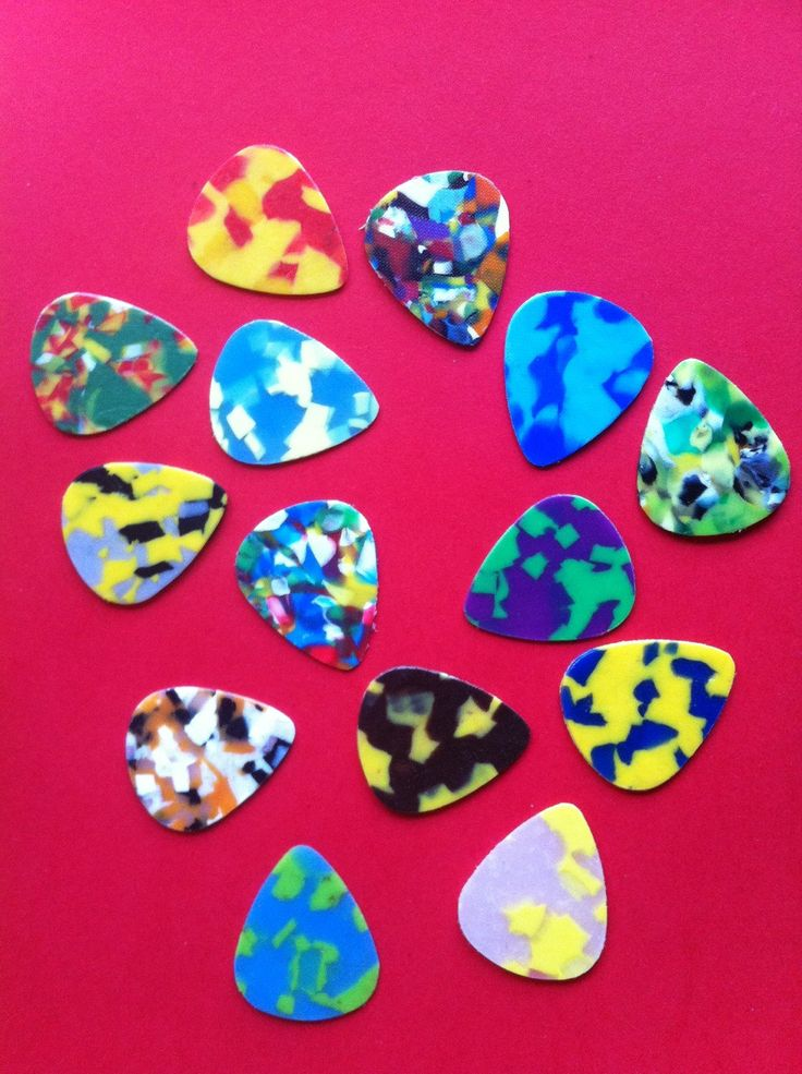 6 Random Colorful Guitar Picks Out Of Recycled Plastic