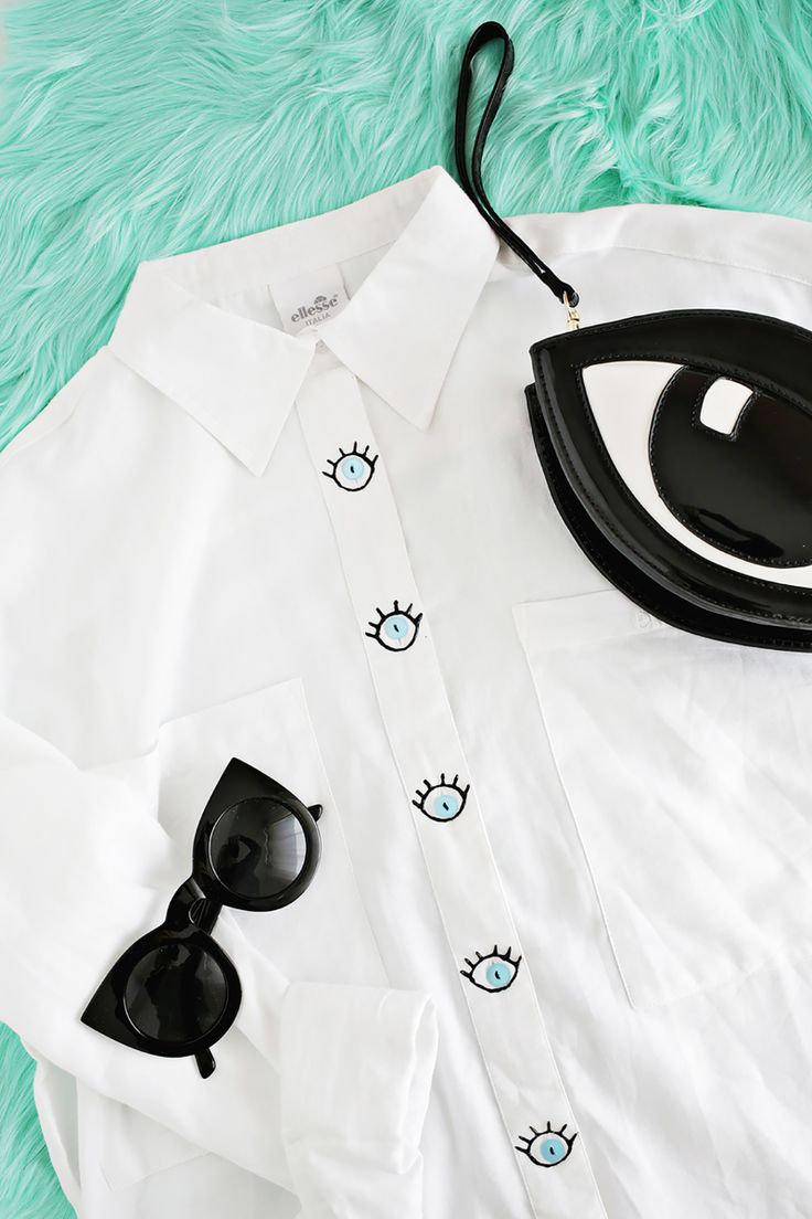 Ha. The post title just makes me laugh. Anyway, I saw a photo of this really cute button-up shirt that had lashes embroidered over the top of each buttonhole, and I thought it would be such a fun DIY to add to my own shirt! Rather than embroider the lashes, I decided to use some good ol' fashioned fabric puff paint (remember those puffy paint days??) to get a clean...