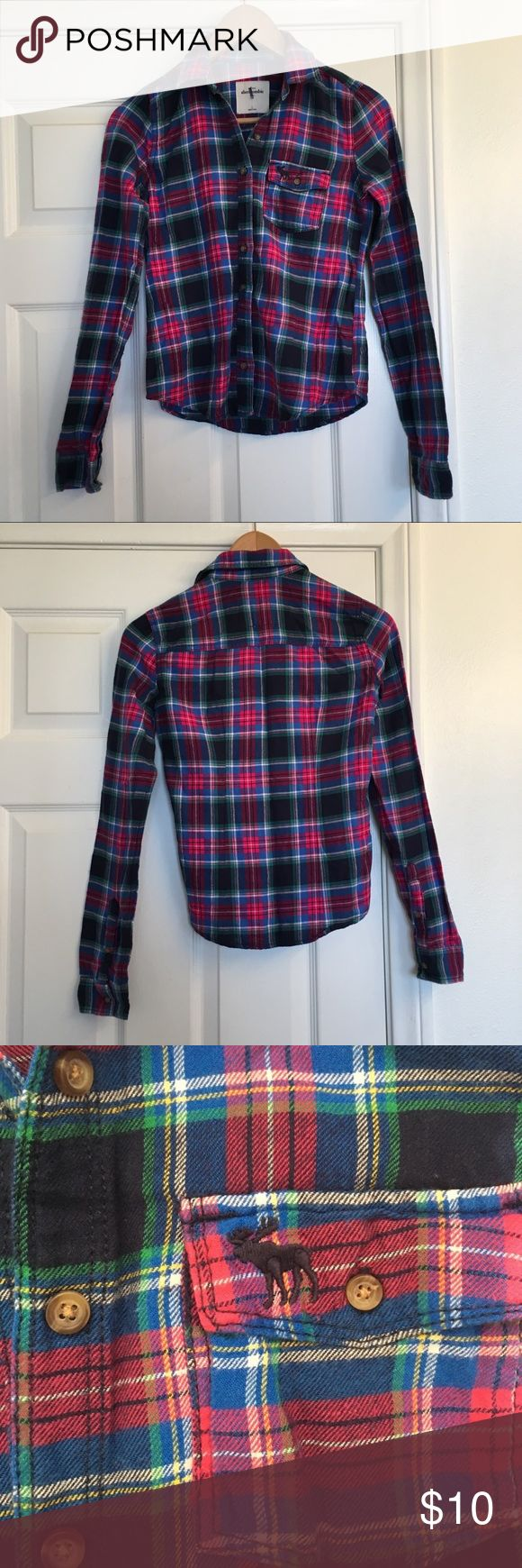Abercrombie Girls Flannel Plaid Button Up Shirt Abercrombie kids plaid button up shirt, pocket in the chest, size large, in great used condition, line through the tag, Armpit to armpit 15 inches, length 21.5 inches Abercombie Kids Shirts & Tops Button Down Shirts