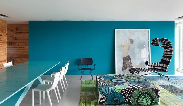 A bit too modern for my taste, but I love the colors and the use of Marimekko's Siirtolapuutarha fabric on the ottoman