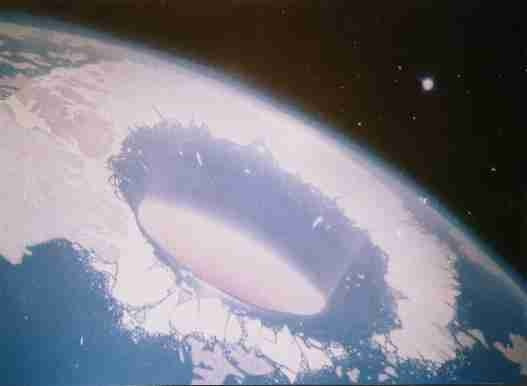 """Real or not, judge yourself: Perhaps the most intriguing photo purporting to show the North Polar opening into the Hollow Earth, this one taken by the American space station Skylab in 1974 - but not released to public view until 2006, and then only because it was leaked to the Internet. This one is so crystal clear it even seems to show sunlight from the so-called 'central sun' emanating from within. Once again, from NASA: 'No comment.' """"Hoax or Smoking Gun? 1880-2008."""""""