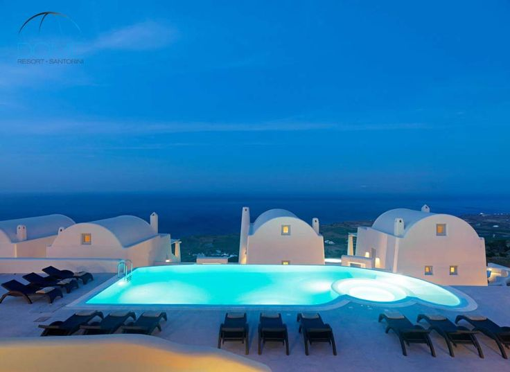 Santorini evenings by the pool...Magical!