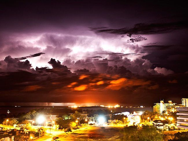 A storm passing over the port of Darwin Australia. Picture: Daniel Courney/Insane Photography