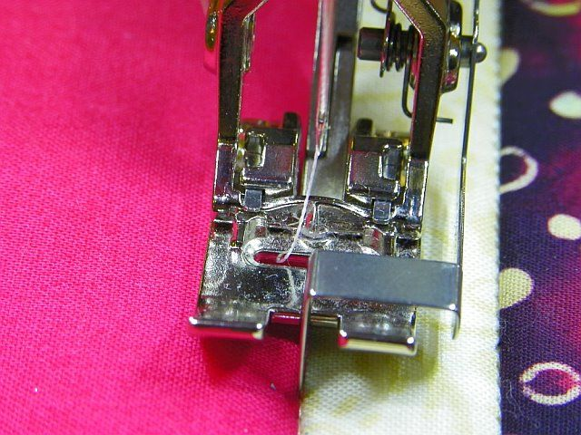 Bernina foot #10 (stitch in the ditch/edge stitch)  I like foot #5 for edge stitching.