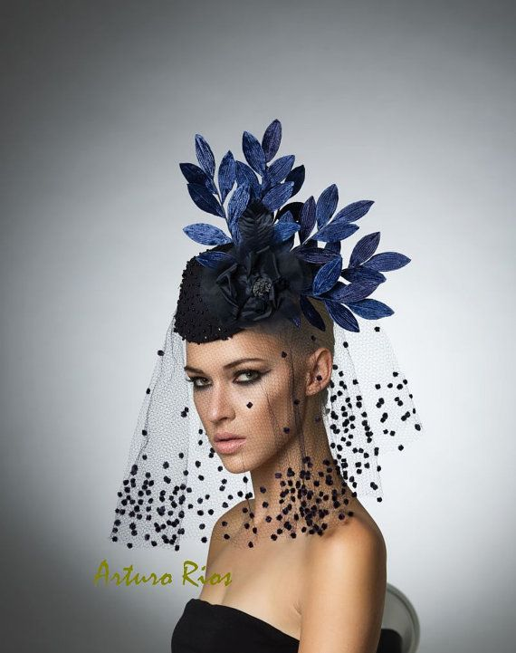 Stunning...!!! is the word to describe this beautiful headpiece from my new collection.    made on a pillbox base covered with a navy beaded silk