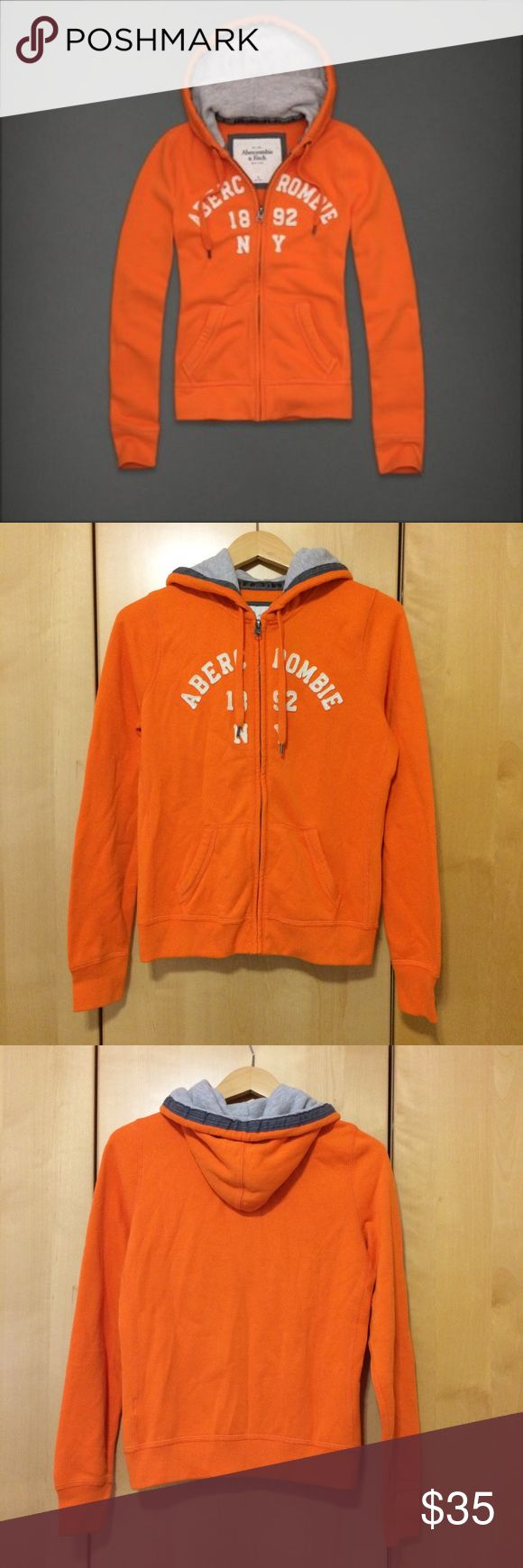 NWT ABERCROMBIE & FITCH Women's Orange Hoodie New with Tag A&F Abigail Orange Zip Up Hoodie Sweater Jacket. CONDITION: Never worn with price tag still attached. WOMEN'S SIZE LARGE. Very soft! Abercrombie & Fitch Jackets & Coats