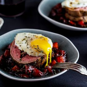 Biltong & parmesan fillet on spiced-plum compote topped with soft egg by Alida Ryder.