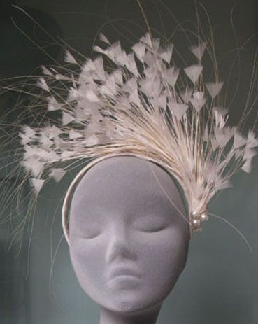 A bit bridal, but gorgeous feather work on this hat