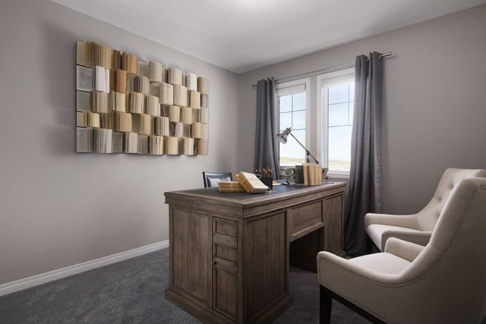 Secondary bedroom decorated as a home office / den  in the Wysteria showhome in the community of Redstone in northeast Calgary