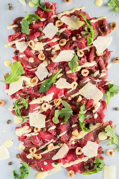 INGREDIENTS BY SAPUTO | Looking for a romantic Italian meal idea? Try our beef carpaccio recipe with Saputo Parmesan Petals and hazelnuts, served with a deliciously creamy cheese sauce. You'll be blown away by how easy it is to prepare!